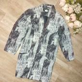 Красивый удлиненный пиджак удлиненный