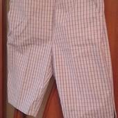Фирменные женские шорты р.12-14 в состоянии новой вещи.