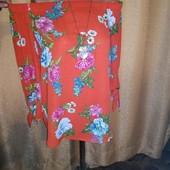Шикарная яркая блузочка с удлиненной спинкой 12/40 размера.