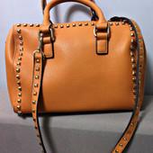 Качественная фирменная сумка из Америки. Из плотного качественного кожзама.