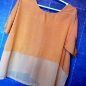 Блузка вільного крою.