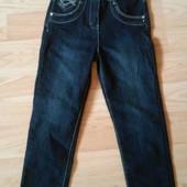 Новые джинсы с бирками.