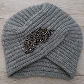 Продам тепленькую шапочку на 5-9 лет.