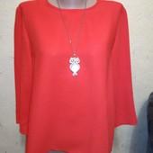 Плотная оранжевая блуза 12/40 размера.