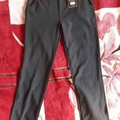 новые женские брюки 48/52