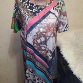 Симпатичное трикотажное платье 14/16 размера.
