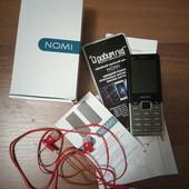 Мобильный телефон Nomi в родной коробке с документами + наушники в подарок!